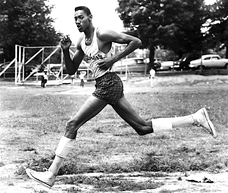 Original caption: 8/6/1954-Philadelphia, PA -It takes a king-size tape measure to cover the seven-foot,one-inch stature of lanky Wilt Chamberlain,17-year-old senior at Philadelphia's Overbrook High School.The youngster stars in track and field as well as basketball,and college and pro scouts are reported giving him a very busy time.Some of the feats that make people take notice of the able lad are:49 seconds for the quarter mile,two minutes for the half,and a record for the shot put.In basketball he's averaging 30 points a game. August 6, 1954 Philadelphia, Pennsylvania, USA