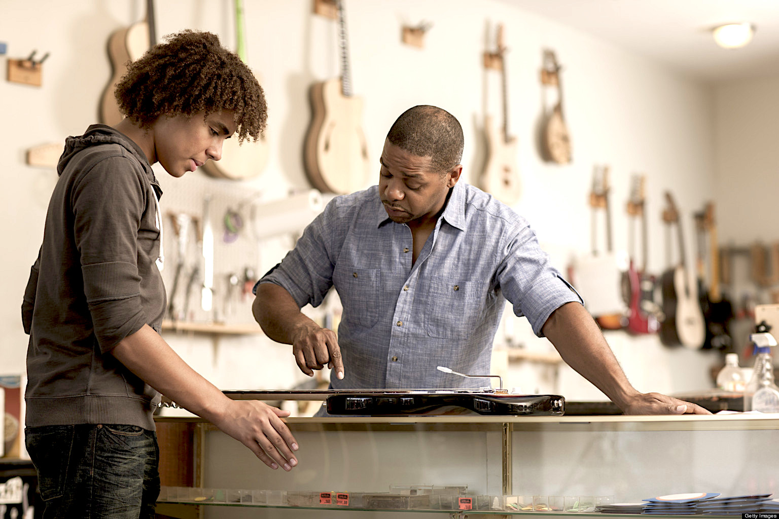 Father and son in music workshop. Credit: Getty Images